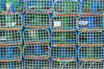 Stacked lobster and crab traps in the port of Santa Luzia