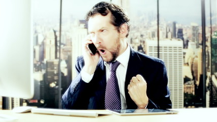 Funny business man celebrating success on the phone
