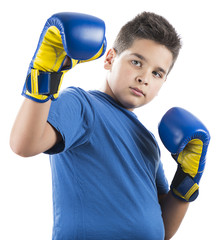 Young champion boy with blue boxing gloves