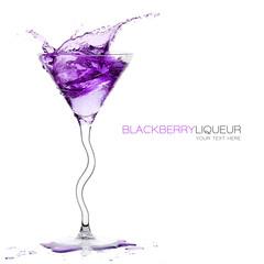 Stemmed Cocktail Glass with Blackberry Liquor Splashing. Templat