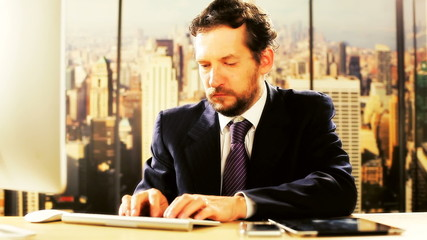Handsome business man working in office in New York