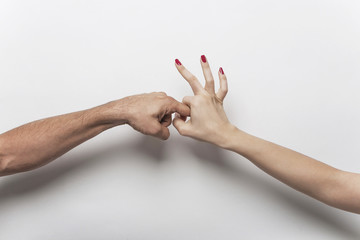 Couple hands making sex gesture