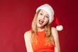 Beautiful girl wearing santa claus clothes