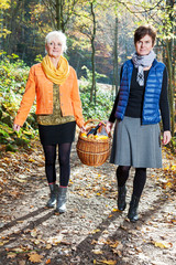 Two women wearing picnic basket