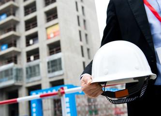 Worker holding a helmet