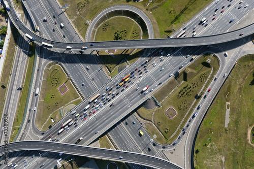 Leinwanddruck Bild Aerial view of highway interchange of a city