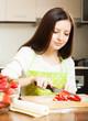 girl cuting strawberry
