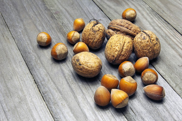 walnuts and hazelnuts on wooden background