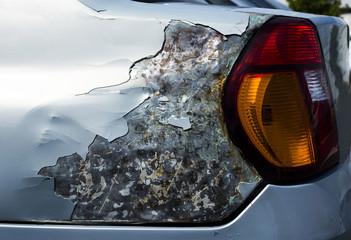 Damaged car, side view