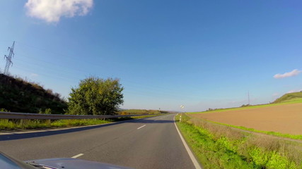 Timelapse driving car small village road, blue sky, summer ride