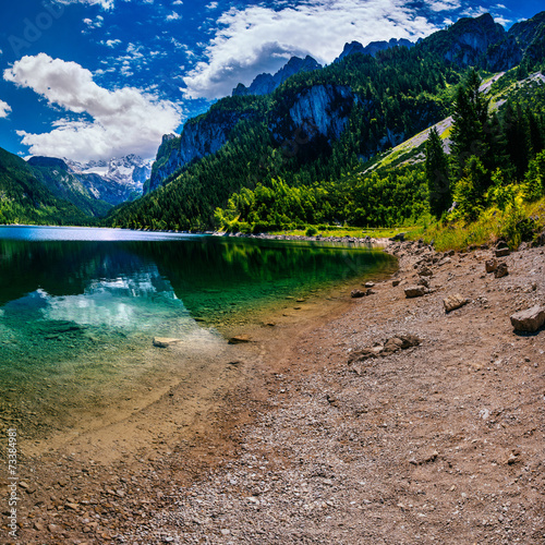 lake between mountains - 73384981