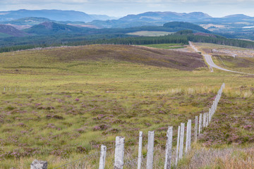 Wooden fence between hills and slopes in the Highlands