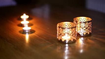 beautiful metallic candlesticks on the table