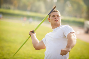 Young athlete throwing the javelin.