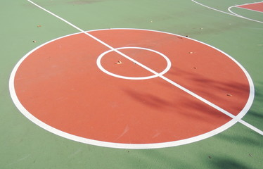 colorful basketball lines on an outdoor court