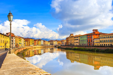 Pisa, Arno river, lamp and buildings reflection. Lungarno view.