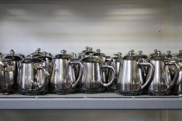 metal teaand coffee pots in commercial kitchen