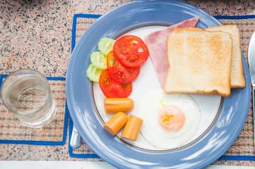 bacon, eggs, tomato and hotdog breakfast