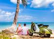 Couple on the beach with retro bike