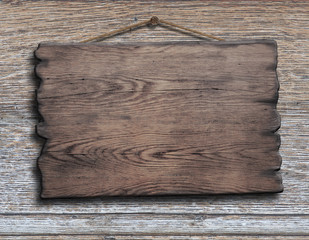 old wood plank or plate hanging on timber plank wall
