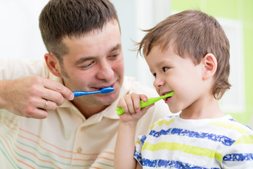 father and kid son brushing teeth