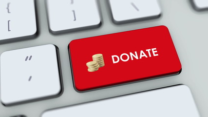 Donate button on computer keyboard. Key is pressed