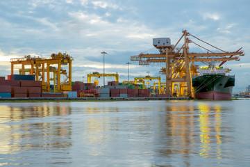 Container Cargo freight ship working crane bridge in shipyard