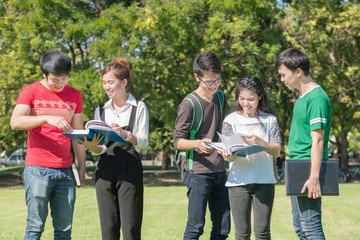 Happy group of students at the park