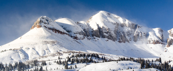 snow mountain range with sunlight, colorado