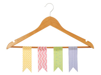 Row of colorful flags hanging on wooden hanger isolated on