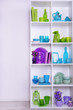 canvas print picture - White shelves with colorful things, close-up