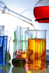 Laboratory glassware on light background