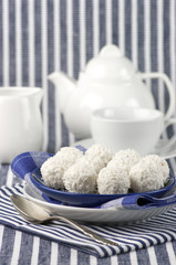 Coconut candies and tea
