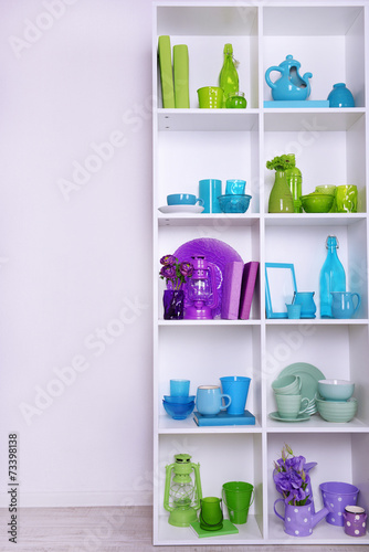 canvas print picture White shelves with colorful things, close-up