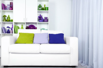 Modern interior design. White living room with sofa and