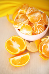 Sweet tangerines and oranges on table close-up