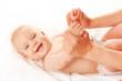 Leinwanddruck Bild - Baby massage. Mother massaging kid hands