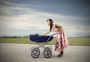 A young woman pushing a stroller