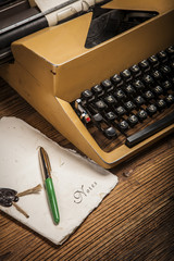 old typewriter, a pile of books and a lot of creativity