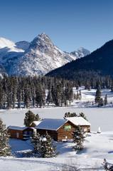barn and the winter snow mountain,colorado