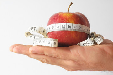 Diet Apple and Meter on the Hand