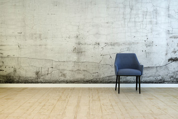 Single armchair in front of a stained wall