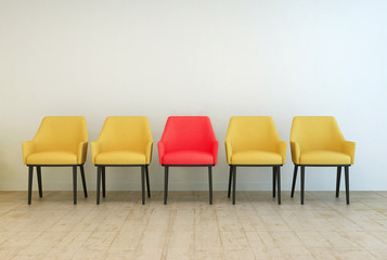 Yellow chairs aligned with a red one in the middle