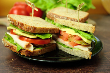 Sandwiches with ham cheese and lettuce