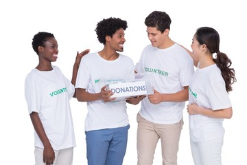Young smiling volunteers collecting donations