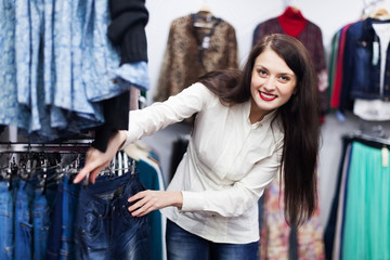 Young Woman choosing jeans