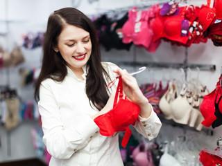 girl choosing bra at fashion boutique