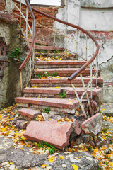 Abandoned grungy stairs outdoors with railings