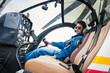 Leinwandbild Motiv Young woman helicopter pilot.