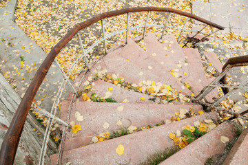 Abandoned grungy stairs with railings in autumn